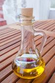 Black olives with bottle of oil — Zdjęcie stockowe