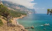 Beach between rocks and sea. — Stock Photo