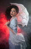 Beautiful Halloween vampire woman aristocrat with lace-parasol — Stock Photo