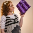 Stockfoto: Beautiful excited girl with a presents