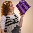 Beautiful excited girl with a presents — Stock Photo