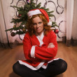 Funny looking bad santa girl — Stock fotografie
