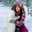 Royalty-Free Stock Photo: Happy woman with dog in winter forest