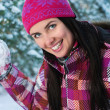 Beautiful young woman outdoor in winter plaing snawballs — Stock Photo