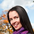 Portrait of young beautiful woman in the park — Stock Photo #12656813