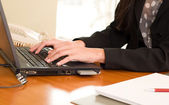 Close up of woman hands typing on laptop — Stock Photo