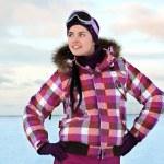 Beautiful young woman wearing skiing suit posing outdoors in win — Stock Photo #13331009