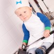 Little baby chef in the cook hat with metal ladle — Stock Photo