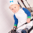 Little baby chef in the cook hat with metal ladle — Stock Photo #13330998