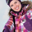 Smiling happy young woman outdoors in winter — ストック写真