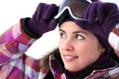 Portrait of smiling happy young woman wearing ski goggles — Stock Photo