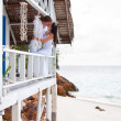 Romantic young couple in tropical beach house — Photo