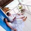 Romantic young couple in tropical beach house — Stockfoto