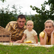 Stock Photo: Happy family picnicking outdoors