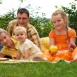 Happy family picnicking outdoors — Stock Photo #13355603
