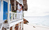 Romantic young couple in tropical beach house — Stock Photo