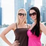 Two beautiful smiling women in Singapore — Stock Photo #13617056