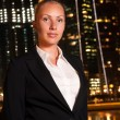 Young business woman in the big city at night — Stock Photo