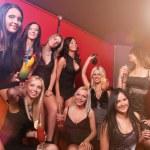 Photo of joyful beautiful friends on the party — Stock Photo #14423047