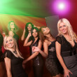 Image of pretty girls dancing in night club -  