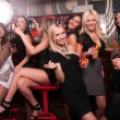 Girls company having fun in the night club - Foto Stock