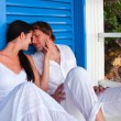 Romantic young couple in tropical beach house - Stock Photo