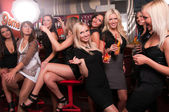 Girls company having fun in the night club — Stock Photo