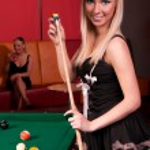 Happy girls playing in billiard — Stock Photo
