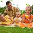 Happy family picnicking outdoors — Stock Photo