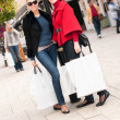 Happy smiling women shopping with white bags — Stock Photo #15840087