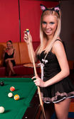 Happy girls playing in billiard — Stock Photo