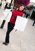 Happy smiling woman shopping with white bags — Stock Photo