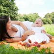Young happy mother with daughter in the park — Stock Photo