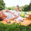 Young happy mother with daughter in the park — Foto Stock