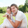 Young happy father with daughter in the park — Stock Photo #36459397