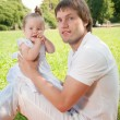 Young happy father with daughter in the park — Stock Photo