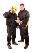Two Engineers looking at tablet pc isolated on white background — Stock Photo