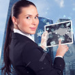 A young businesswoman in the front of a business district — Stock Photo #41508937