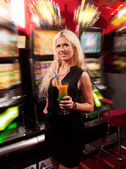 Young woman in Casino on a slot machine — Stock Photo