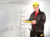 Contractor worker with helmet planning building process — Stockfoto