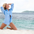 Sensual happy blonde woman on the beach in men's shirt — Stock Photo #9251317