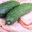 Two cucumber on ham meat - Stock Photo