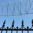 Stock Photo: Barbwire on sky background