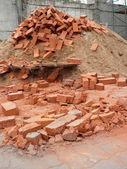 Heap of red brick — Stock Photo