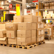 Stock Photo: Rack stack arrangement of cardboard boxes in store warehouse
