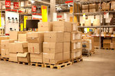 Rack stack arrangement of cardboard boxes in a store warehouse — Stock Photo