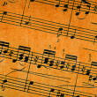Music notes on old paper sheet background — Foto de Stock