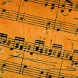 Stock Photo: Music notes on old paper sheet background