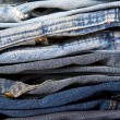 Stack of blue jeans new — Stock Photo