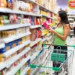 Woman checking food labelling — Stock Photo